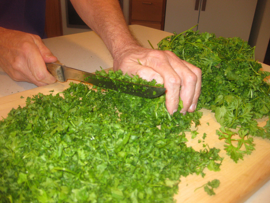 Cutting the parsley and cilantro